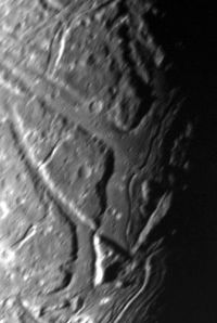 closeup of the surface of Uranus's moon Ariel