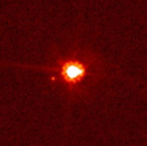 The dwarf planet Eris, with its moon, Dysnomia