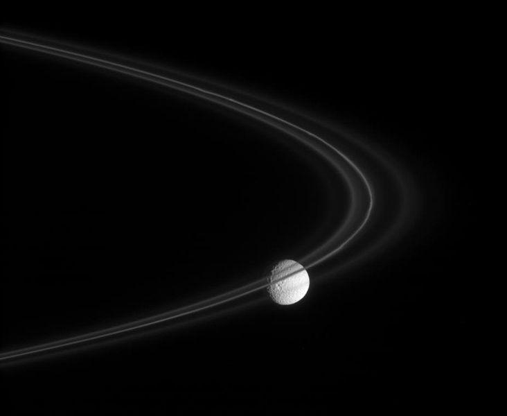Saturn's moon Mimas behind the F Ring