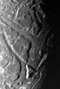 closeup of the surface of Uranus's moon Ariel